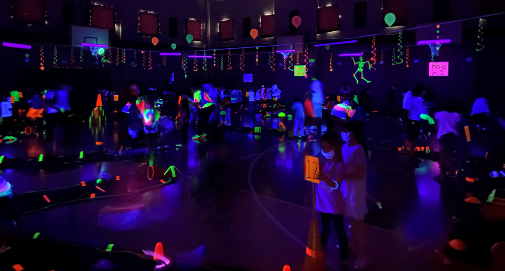 Andy Woods Elementary School Transforms Gym into Neon Putt-Putt Course