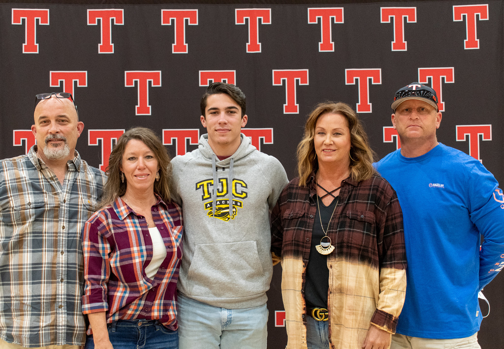 Tyler Legacy Senior, Colby Harris, posing with his family after signing.