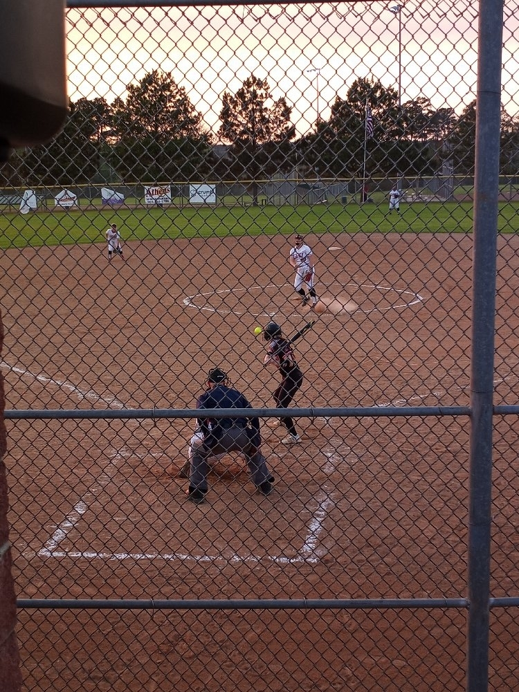lady raiders pitcher throws a strike