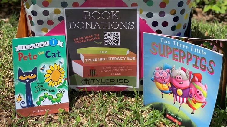books staged in the grass to donate