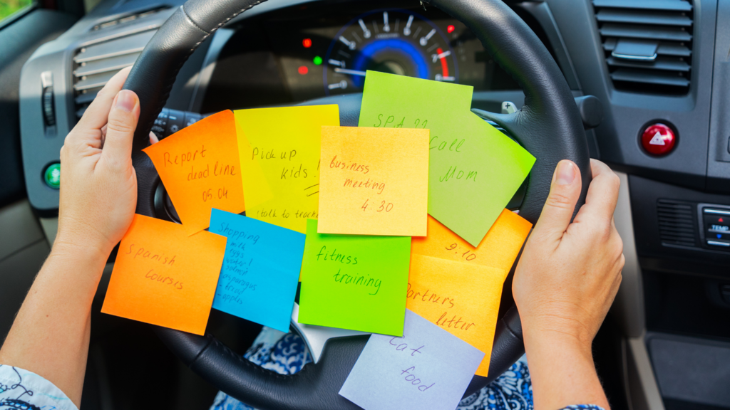 Mom with todo list all over steering wheel.