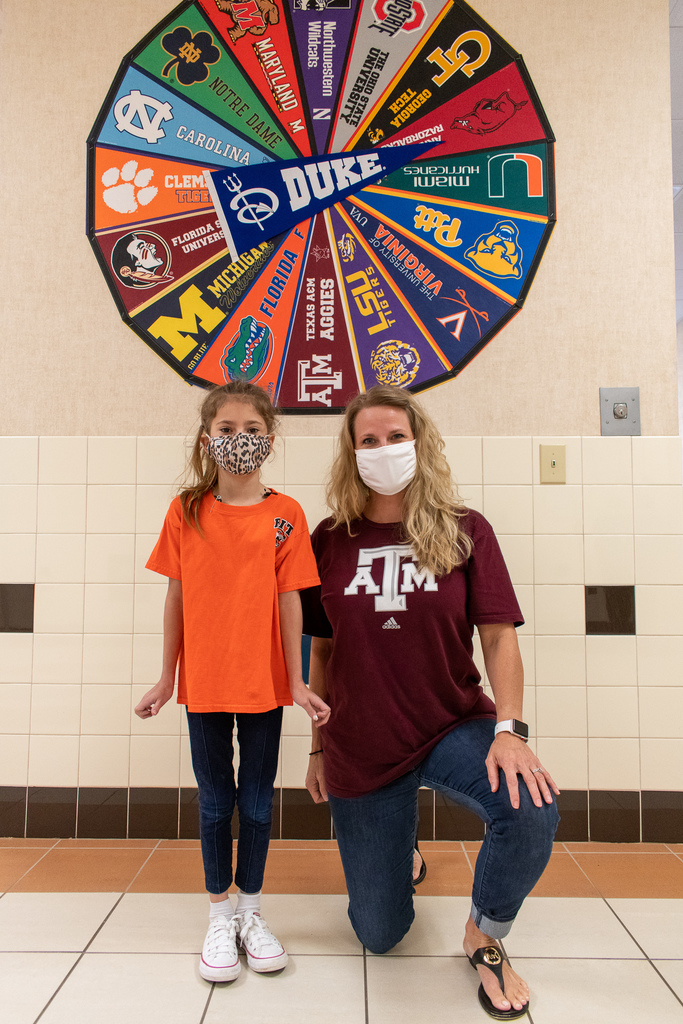 teacher and student wearing college shirts for national college colors day