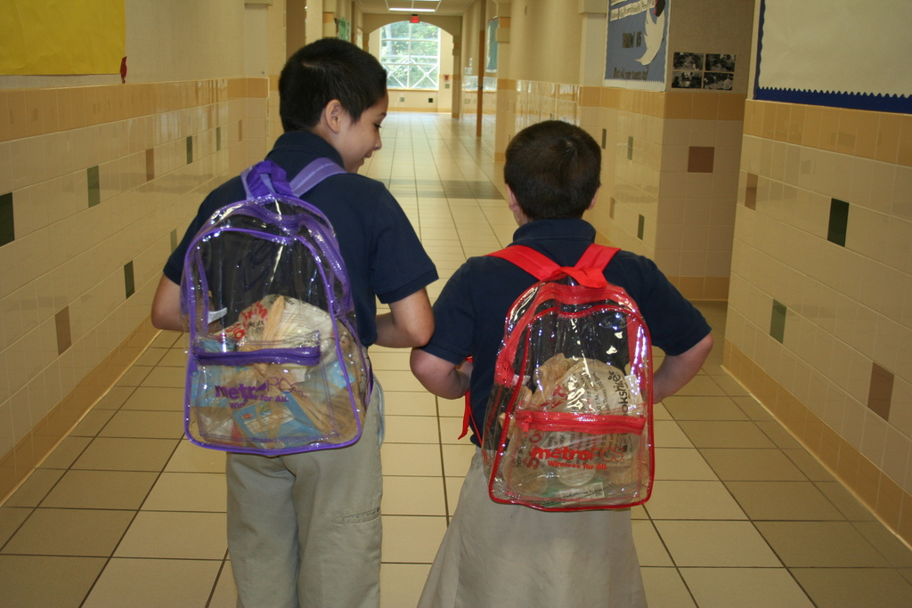 two children with food in backpacks from ETFB backpack program